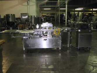 TL Systems Model UD 1100 Vial Filling And Stoppering Line