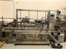 Liquid Packaging Solutions 4 Head S/S Piston Filler