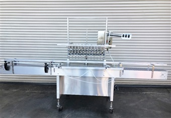 FEC 12 Head S/S Inline Automatic Filler - SOLD